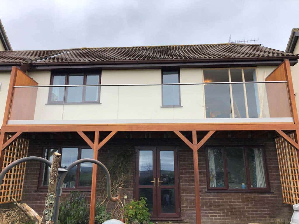 glass balconies on a modern home