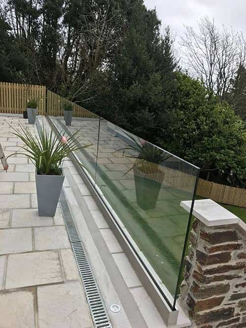 glass balcony looking over a garden