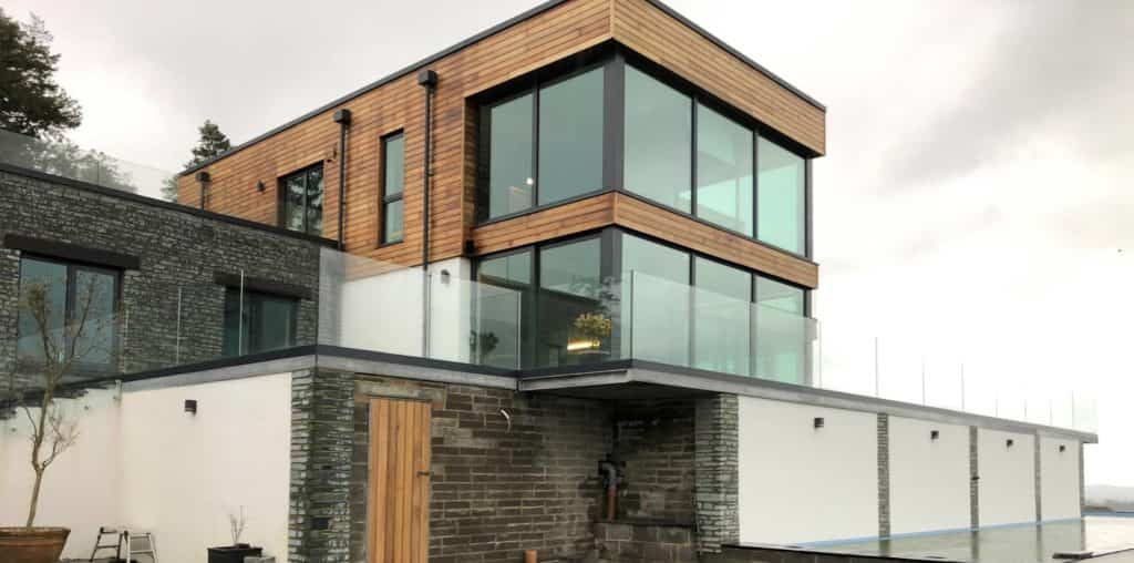 modern home with glass balconies