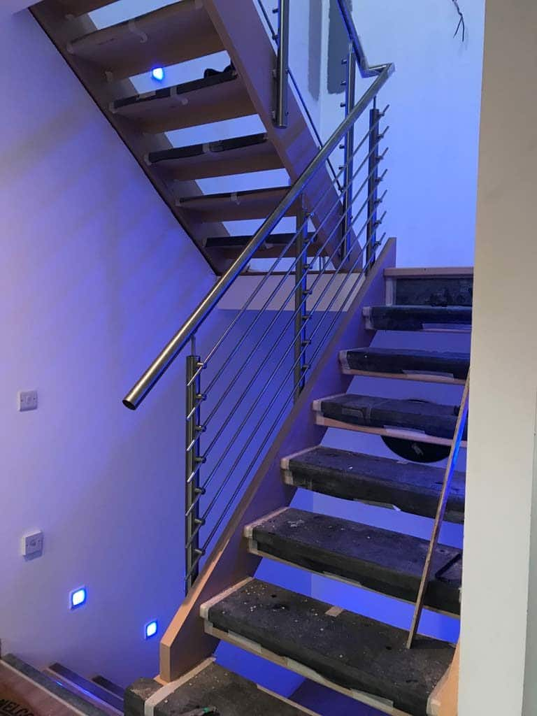 stairwell with metal handrails